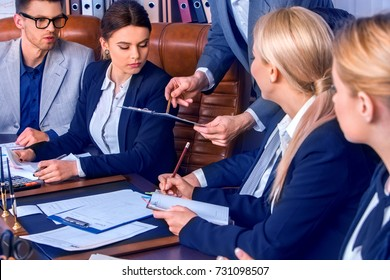 Business people office life of team people working with papers sitting table. Schemas and diagrams close up. Work of accountant. Chief explains task to staff.