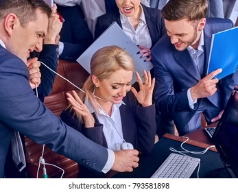 Business people office life of team people working with papers sitting table . Conflict new employee and business company . One staff member strangles her with computer mouse