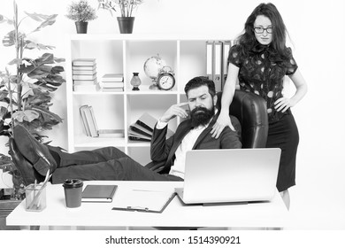 Business people and office staff. Sexy secretary personal assistant. Typical office life. Man bearded hipster boss sit in leather armchair office interior. Boss and secretary girl at workplace.