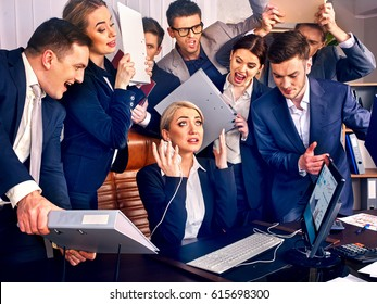 Business people office. Team people are unhappy with their leader. Intern manager does not cope with his duties. Crowd in stress.