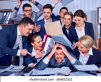 Business people office. Team people are unhappy with their leader. Intern man manager does not cope with his duties. Crowd in stress throw up their chief's papers New employee on the first working day