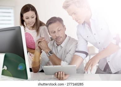 Business people in office working on desktop