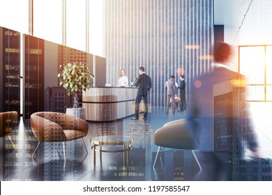 Business people in ofice reception area with long wooden reception table, gray and black walls, panoramic windows and leather armchairs near neat round coffee tables. Toned image double exposure blur