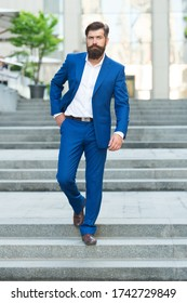 Business people. On his way to success. Walking down street. Mature hipster with beard on stairs. Bearded man in business centre. Confident brutal man walk street. Businessman in formal clothes.