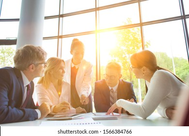 Business people on meeting with lens flare