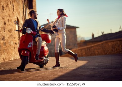 Business people on scooter.scooter in the city. Young Happy couple riding scooter.
