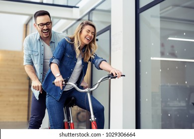 Business people on twin bicycle