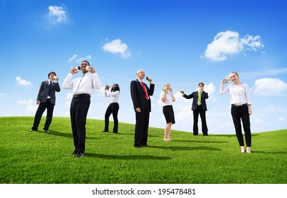 Business People Outdoors Talking Through Tin Can Phone