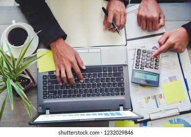 Business people partner negotiating a contract, they are pointing on a document and discussing together,Two businessmen are negotiati