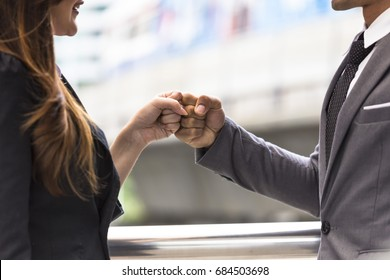 Business people of a Partnership Team Giving Fist Bump after complete deal. Successful Teamwork Partnership in an Office,city background