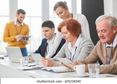 Business people in PC computer workshop as a team