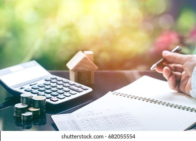 Business People Planning Strategy Analysis Office Concept  for saving or investment for a house, retirement