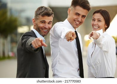 Business People pointing at you.