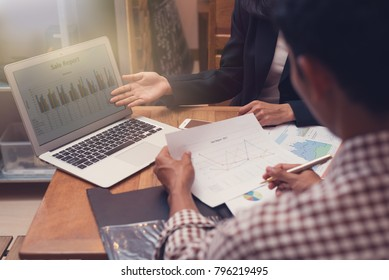 Business people presentaion with tablet screen finance and paper charts finance at the table in room meeting at the office