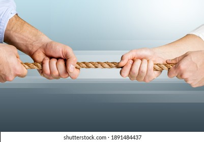 Business people pulling the rope in opposite directions
