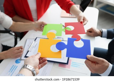 Business people put multi-colored puzzles into one. New ideas for business development concept