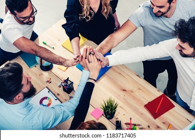 Business people putting their hands together. Concept of integration, teamwork and partnership