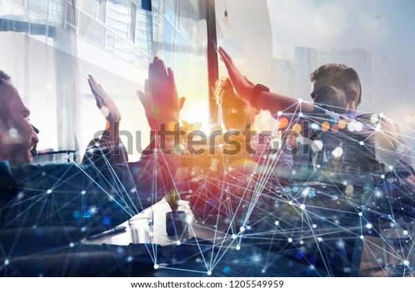 Business people putting their hands together. Concept of startup, integration, teamwork and partnership. Double exposure with internet network effects