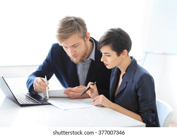 Business people reading contract in the office