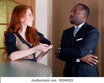 Business people - red head freckled young woman and black man standing - series of photos