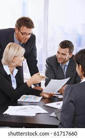 Business people reviewing contract at meeting in office.?
