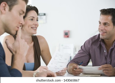 Business people reviewing documents during meeting in conference room