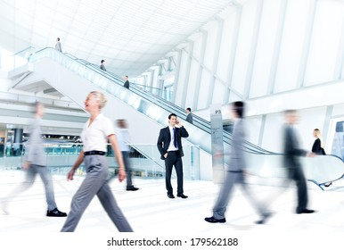 Business People at Rush Hour in Office Building