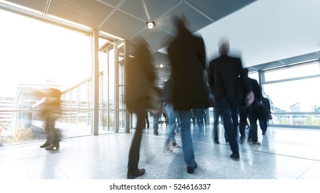 Business People rushing to a traid fair