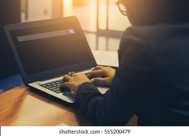 business people search web and technology concept of using internet browser on laptop computer on table