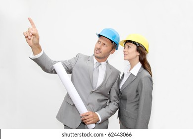 Business people with security helmet on white background