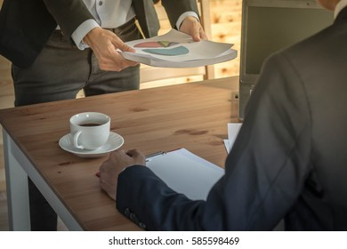 Business people send chart document and discussing the charts and graphs showing the results of their successful teamwork in meeting room, selective focus. Business concept idea background.