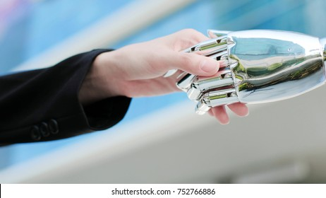 business people shake hands with ai robot