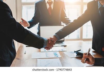 Business people shake hands with business partners at a meeting. The concept of organizational dispute settlement.