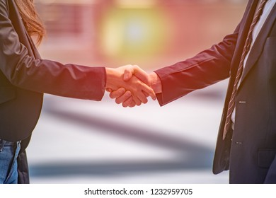 Business people shake hands together, Doing business with teamwork.