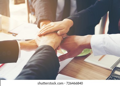 Business people Shakes Hands and fist bump showing Trustworthy team work business etiquette am pleased With mergers and Acquisition .partnership marketing sales team collaborate with competitors