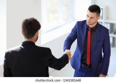 Business people shaking hands after good deal. Business partnership meeting concept