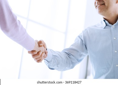 Business people shaking hands after a successful meeting, business relationships and cooperation concept