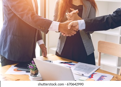 Business people shaking hands after finishing up a meeting good teamwork in office.Teamwork successful Meeting Workplace strategy Concept.