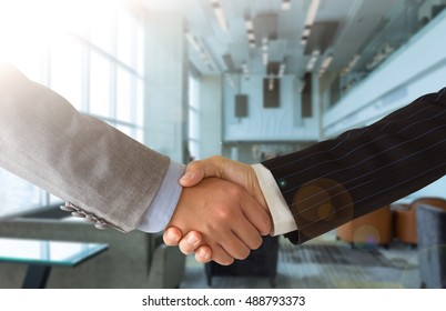 Business people shaking hands congratulating the successful business deals.