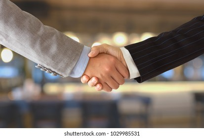 business people shaking hands for congratulation to success business deal.