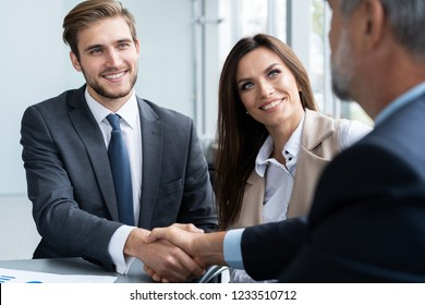 Business people shaking hands, finishing up a meeting. Handshake. Business concept