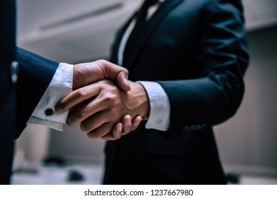 Business people shaking hands, finishing up a meeting,Negotiations were successfully