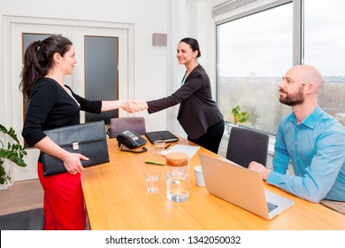 business people shaking hands finishing up meeting. Introducing them self in a job interview.