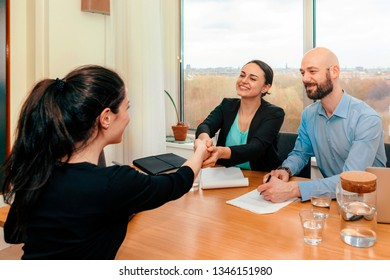 business people shaking hands finishing up meeting / job interview / sign contract