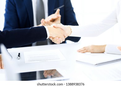 Business people shaking hands finishing up a meeting , close-up. Success at negotiation and handshake concepts. Group of lawyers at work