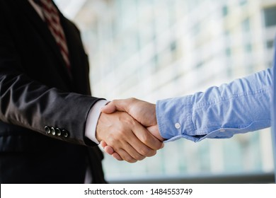 Business people shaking hands, finishing up a meeting.Success teamwork, partnership and handshake