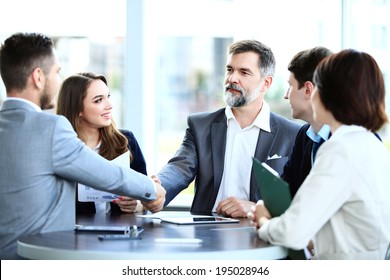 Business people shaking hands, finishing up a meeting  - Shutterstock ID 195028946