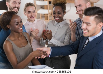 Business people shaking hands, finishing up a meeting multi-ethnic group of people