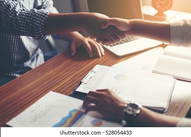 Business people shaking hands, finishing up a meeting Handshake Business concept