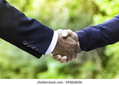 Business people shaking hands, finishing up a meeting, after successful deal.